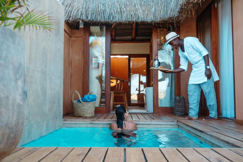 Eclectic Beach Retreat splash pool